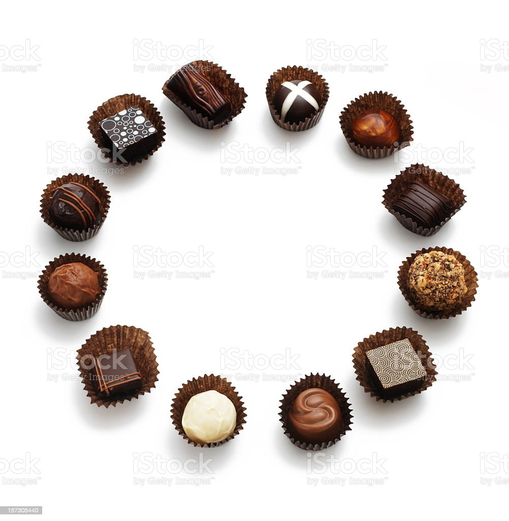 Assorted chocolates on a white backdrop stock photo