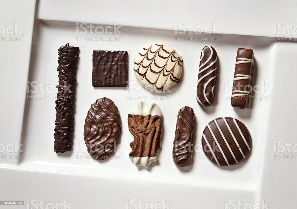 Assorted Chocolates on White Plate royalty-free stock photo