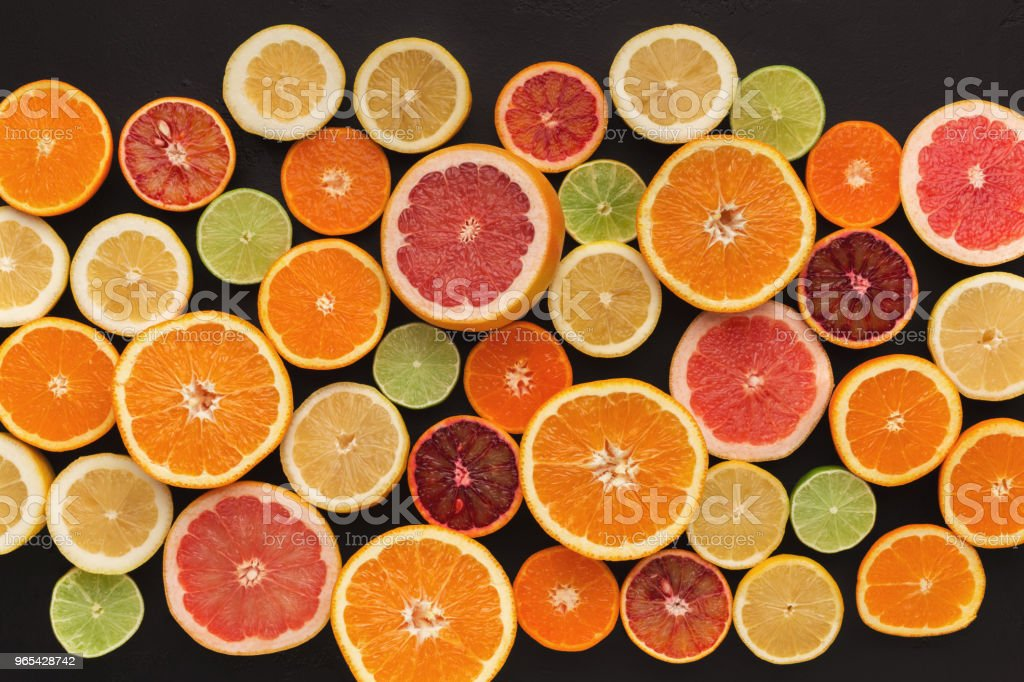 Assorted cirtus fruits background, top view royalty-free stock photo