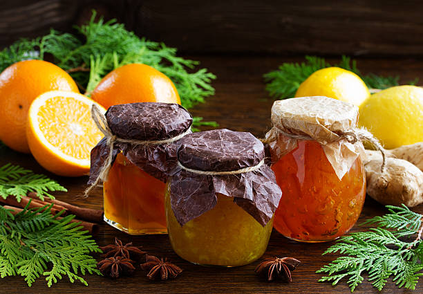 Assorted citrus fruit preserves prepared for Christmas. stock photo