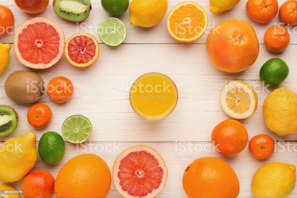 Assorted citrus fruits on white wooden planks, top view royalty-free stock photo