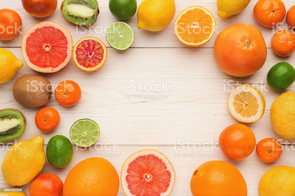 Assorted citrus fruits on white wooden planks, top view zbiór zdjęć royalty-free