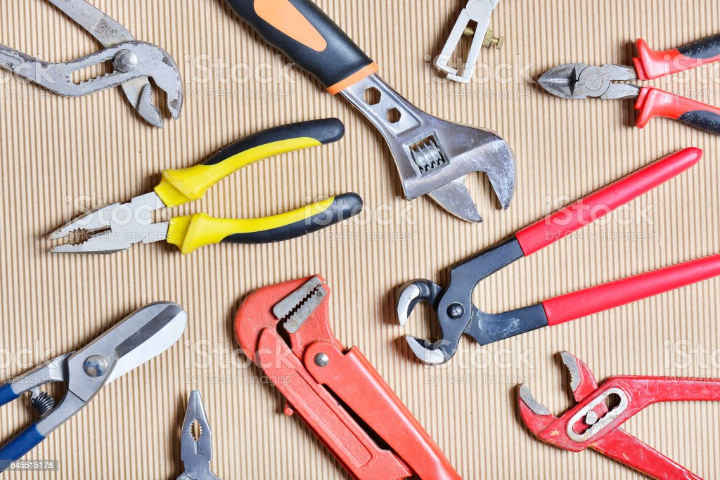 Assorted clamps and pliers flat view stock photo