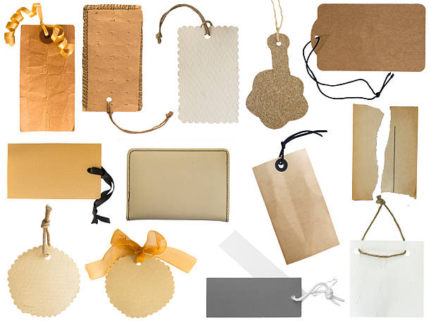Assorted collection of tags and notes on a white background stock photo