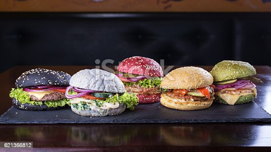 istock Assorted colored burgers 621366812