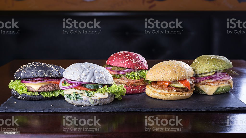 Assorted colored burgers stock photo