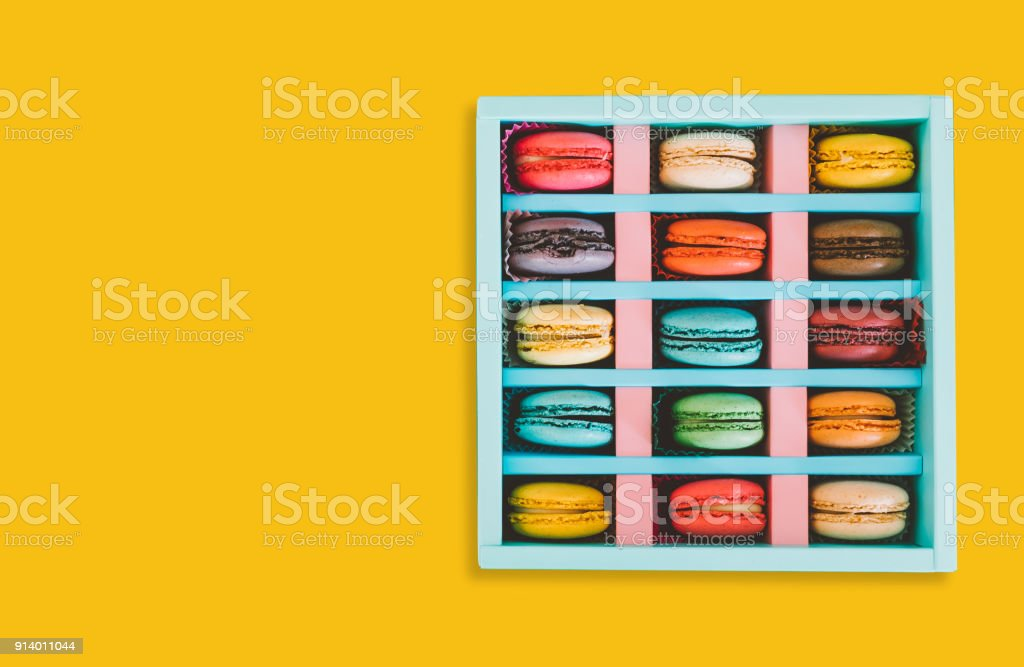 Different colour and kind of french cookie macarons in a paper box on...