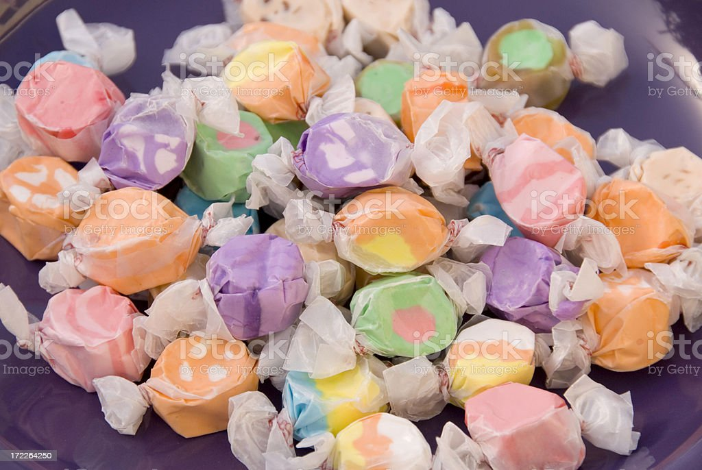 Assorted Colorful Wrapped Salt Water Taffy Candy, Sweet Food Background stock photo