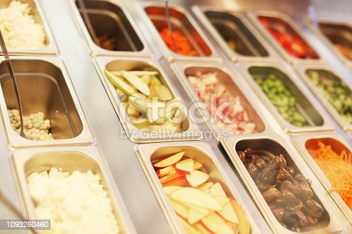 assorted condiments and toppings at a supermarket