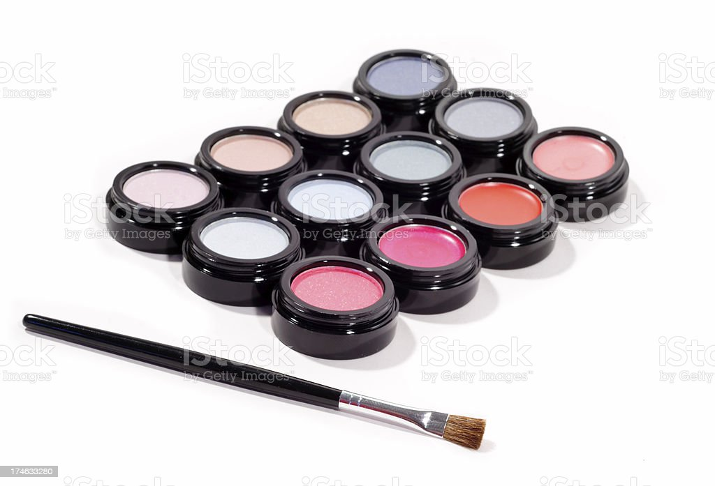 Assorted Cosmetics and a Makeup Brush royalty-free stock photo