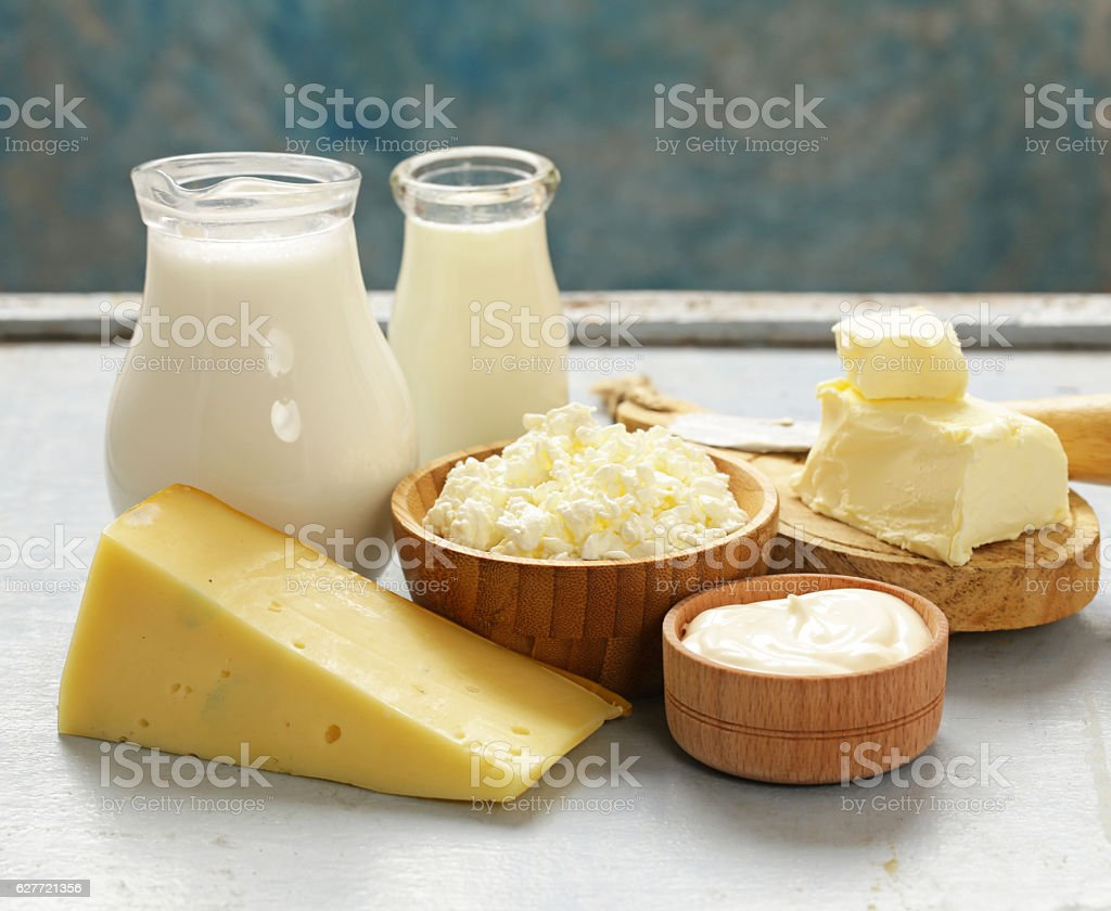 Assorted dairy products (milk, yogurt, cottage cheese, sour cream) stock photo