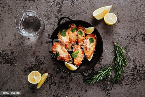 istock Assorted delicious grilled barbecue meat and seafood. 1057654016