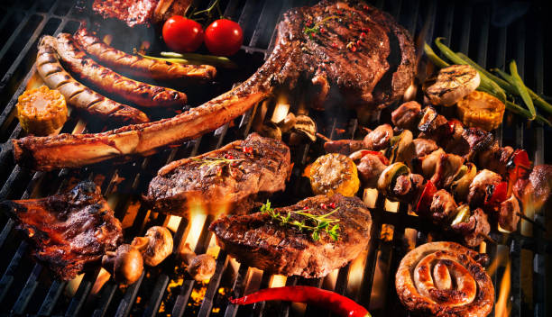 Assorted delicious grilled meat on a barbecue stock photo