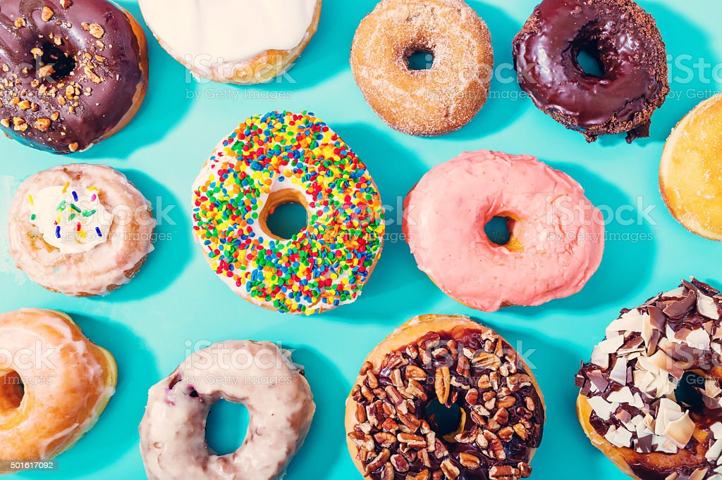 Assorted donuts on pastel blue background stock photo