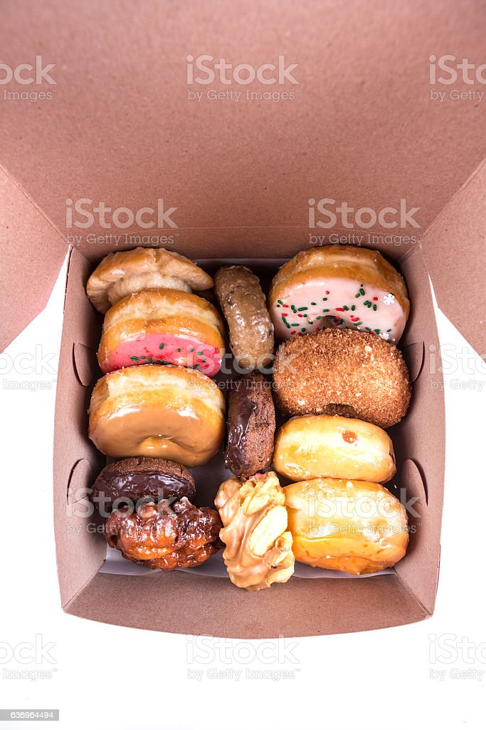 Assorted dozen donuts in a box stock photo