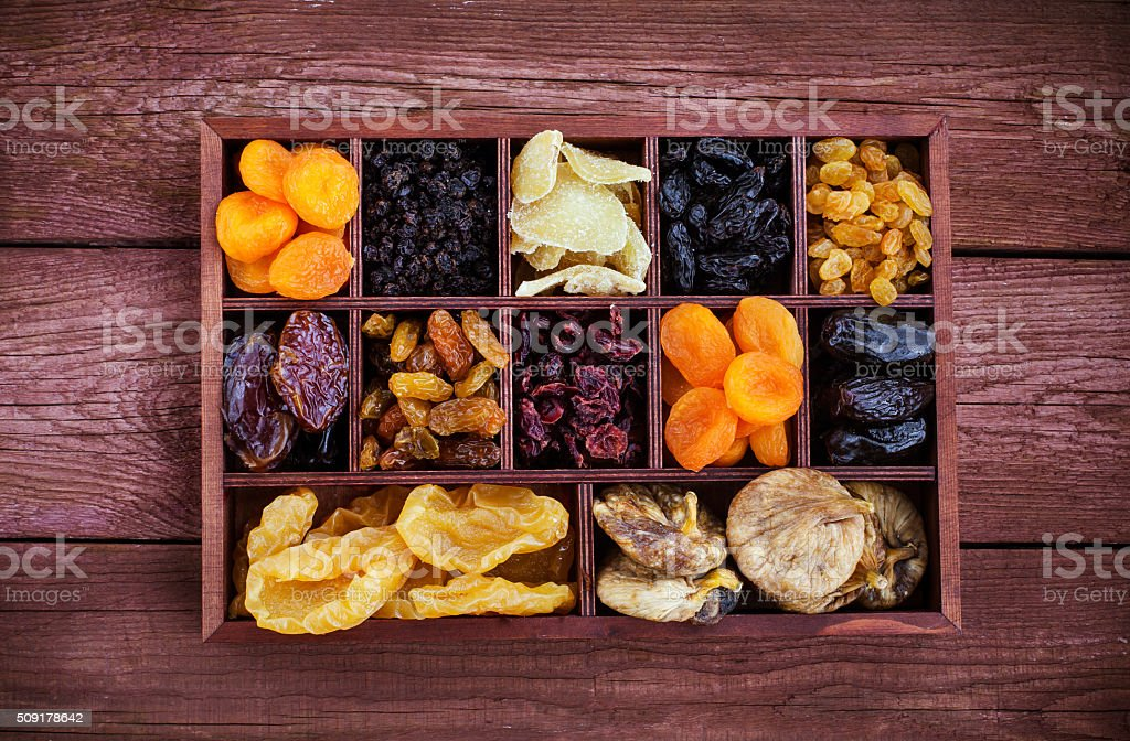 Assorted dried fruits in wooden box stock photo