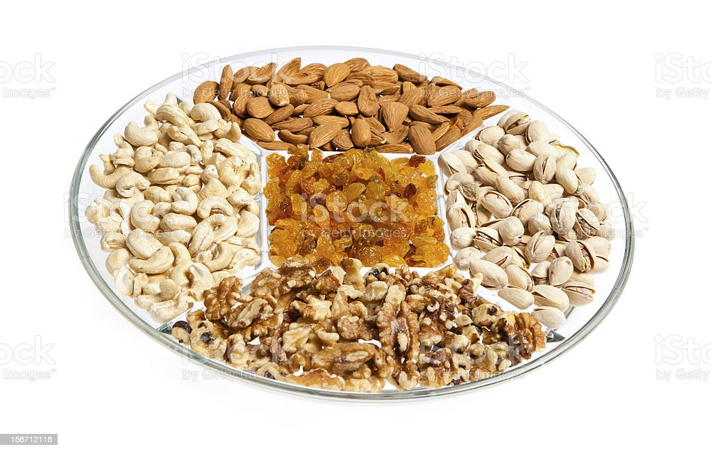 Assorted Dry Fruits and Nuts in a Plate stock photo