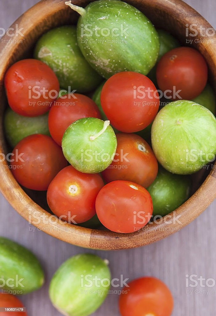 Assorted fresh colorful cucumbers and  cherry tomatoes royalty-free stock photo