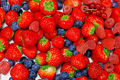 assorted fresh mix berry fruits with white background