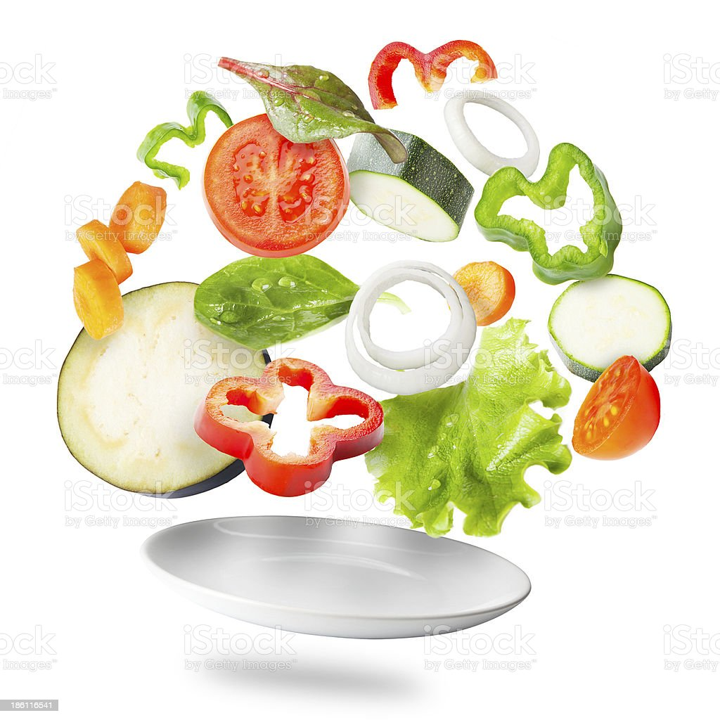 Assorted fresh vegetables flying in a plate stock photo