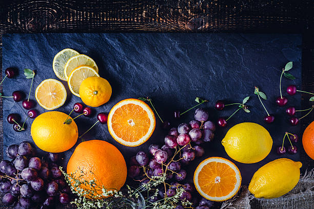 Assorted fruit on the dark background top view – Foto