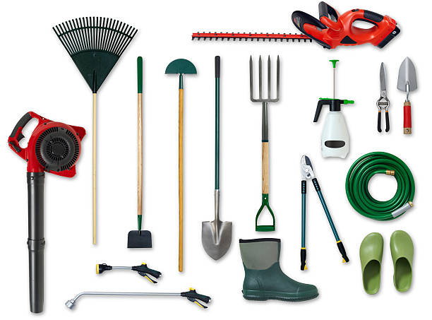 Assorted garden tools isolated on white background Different types of gardening tools and boots are shown against a white background.  The collection includes a spade, a leaf blower, a hosepipe, a gumboot and a lawn rake. gardening equipment stock pictures, royalty-free photos & images