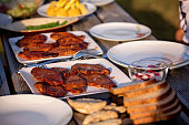 Assorted grilled meats and vegetables on a white wooden table. Healthy eating