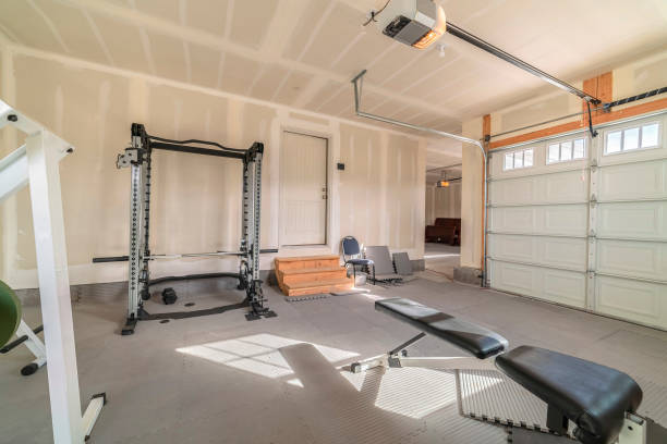 Assorted gym and fitness equipment in a garage stock photo