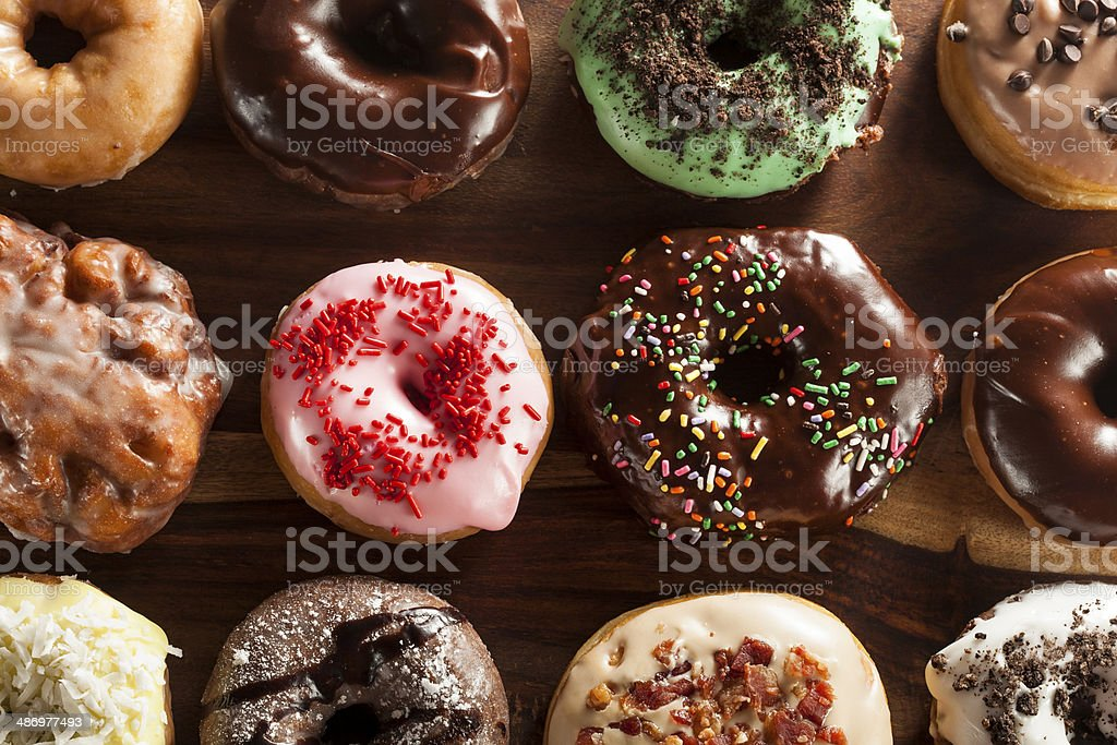 Assorted Homemade Gourmet Donuts on a Background stock photo