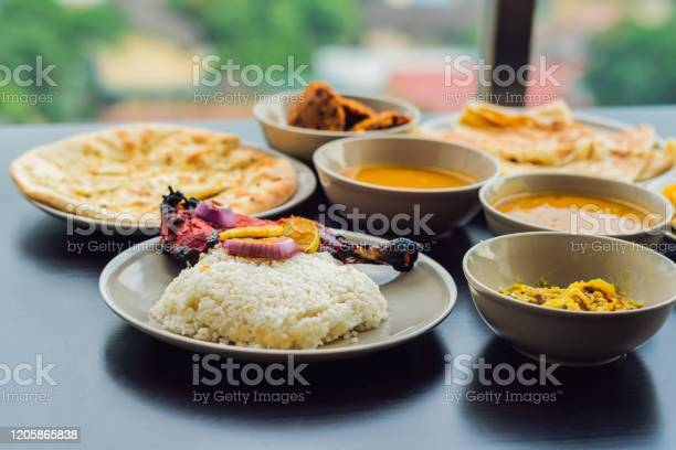 Assorted indian food on dark wooden background dishes and appetizers picture id1205865838?b=1&k=6&m=1205865838&s=612x612&h=doc4yvuti24ez7unqtrtmytm2wcy3qex7p0uizeqi3s=