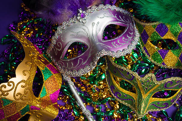 assorted mardi gras or carnivale mask on a purple background - pärla sytillbehör bildbanksfoton och bilder
