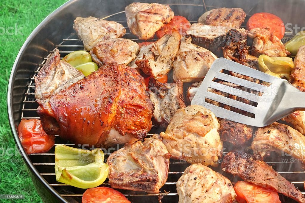 BBQ Assorted Meat And Vegetables On The Hot Flaming Grill stock photo