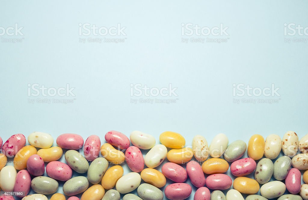 Assorted multicolored jelly beans with copyspace. stock photo