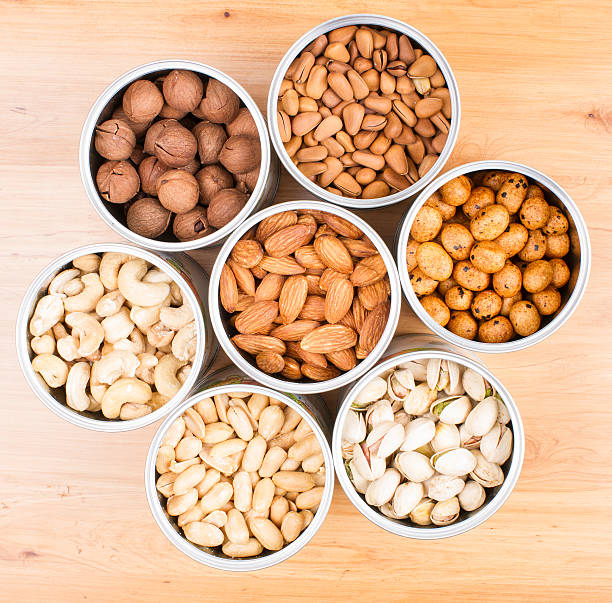 Assorted nuts in Iron pot stock photo