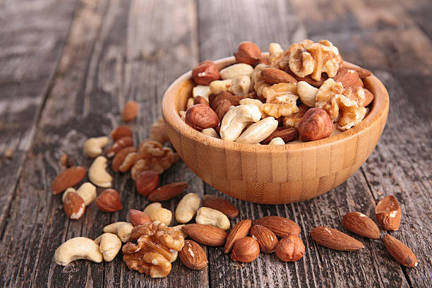 assorted nuts assorted nuts walnut stock pictures, royalty-free photos & images