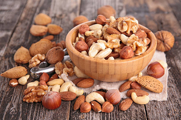 assorted nuts - dried fruit stock photos and pictures