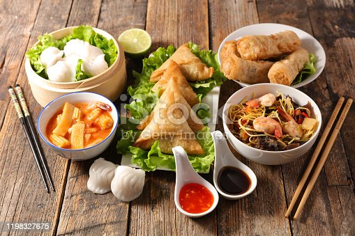 assorted of asian food, spring roll- samossa- dim sum- fried noodles