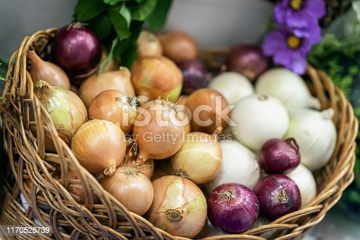 Assorted onions of different varieties. Basket with fresh organic vegetables closeup, Live vitamins, selectiv focus. Farmers market