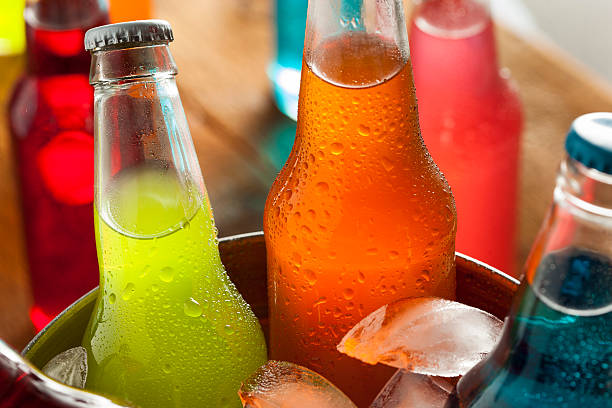 assorted organic craft sodas - soda pop stock photos and pictures
