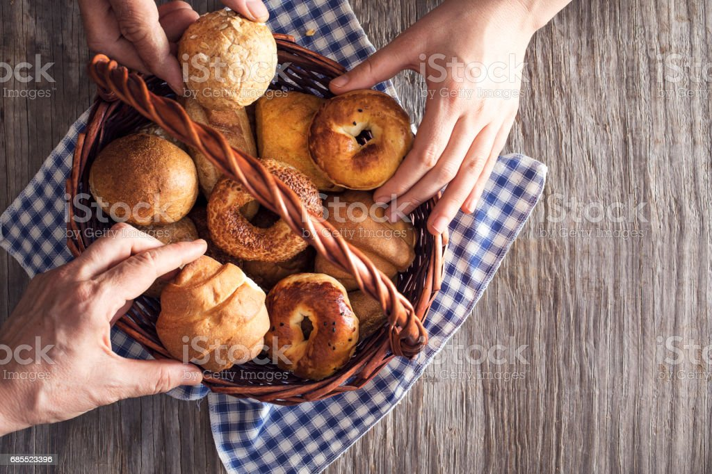 Assorted pastries in straw basket stock photo