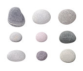 'Assorted pebbles, isolated on white background.'