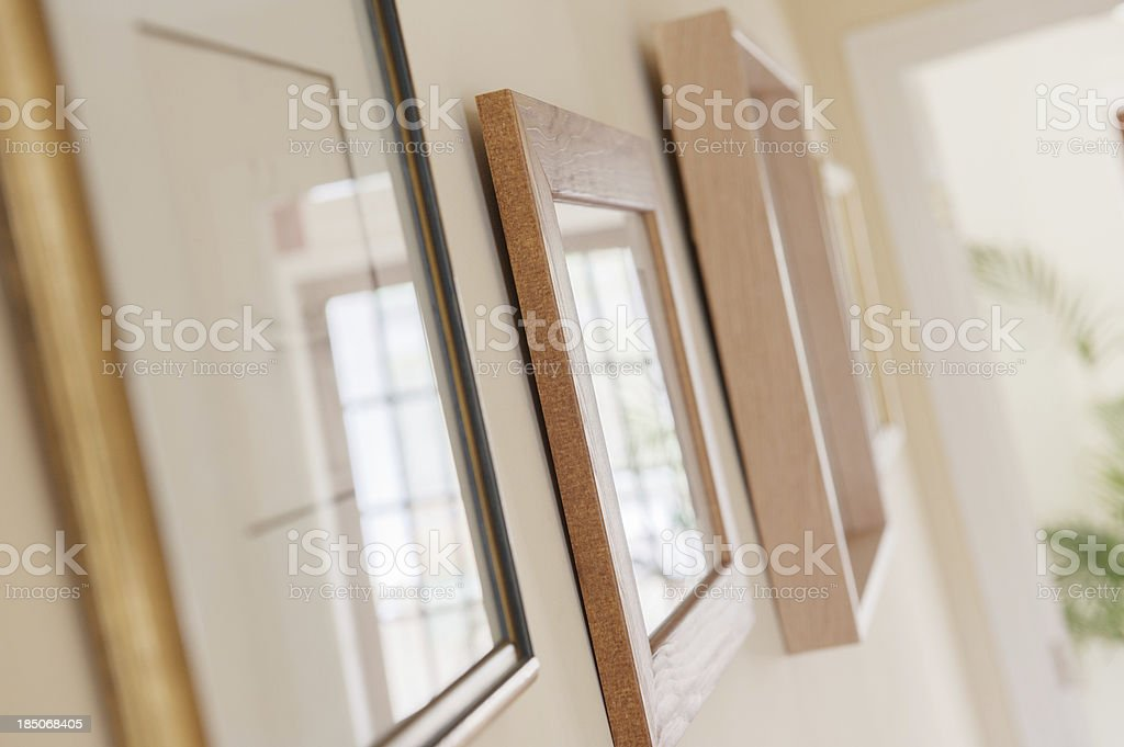 Assorted Picture Frames Decorating Wall Of Warm Light Modern Apartment royalty-free stock photo