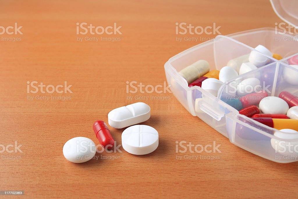 Assorted pill box close up stock photo
