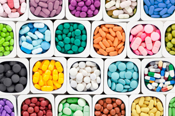 assorted pills - vitamin stock pictures, royalty-free photos & images