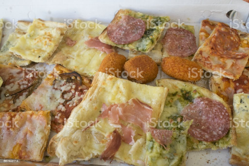 assorted pizza cut in pieces foto stock royalty-free