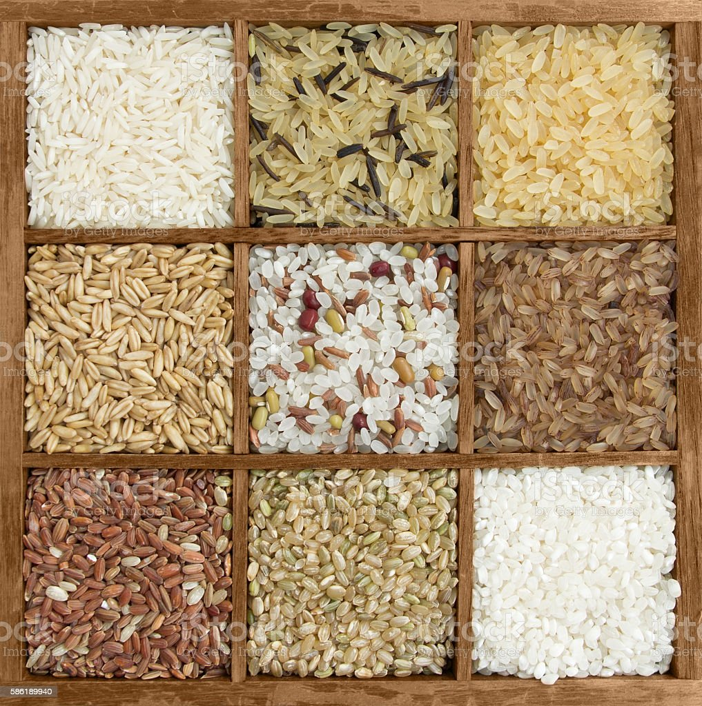 Assorted rices in wooden box stock photo