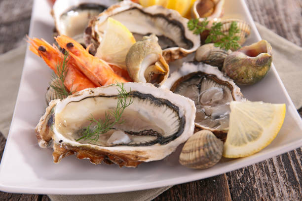 assorted seafood assorted seafood mollusk stock pictures, royalty-free photos & images