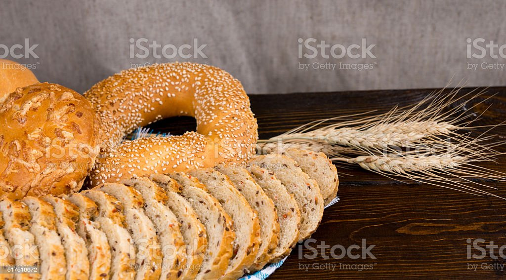 Assorted seeded breads on a rustic table stock photo