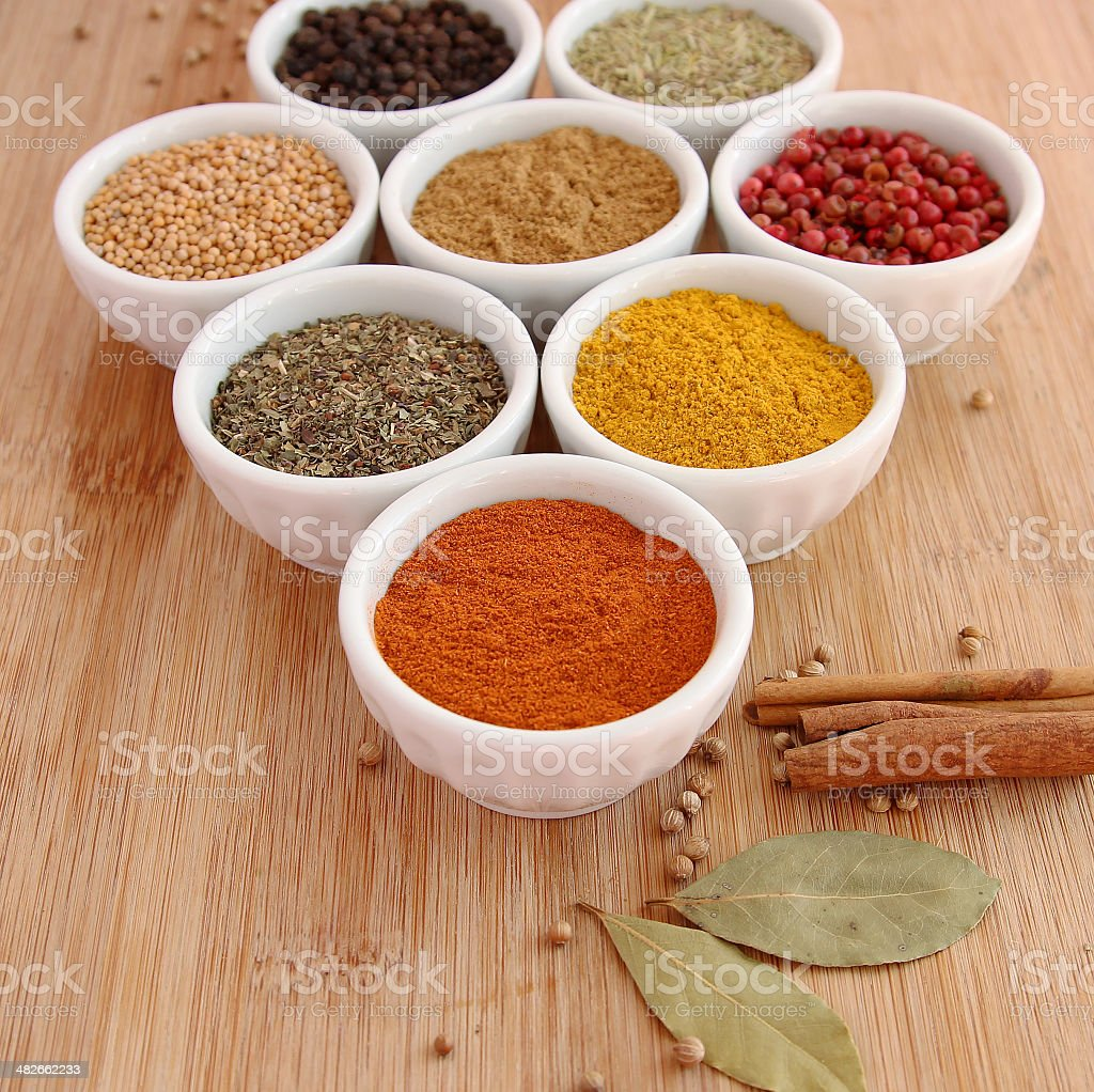 Assorted spices with paprika in the foreground stock photo