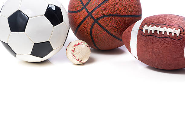 Assorted Sports Balls on white background - soccer, football, ba stock photo